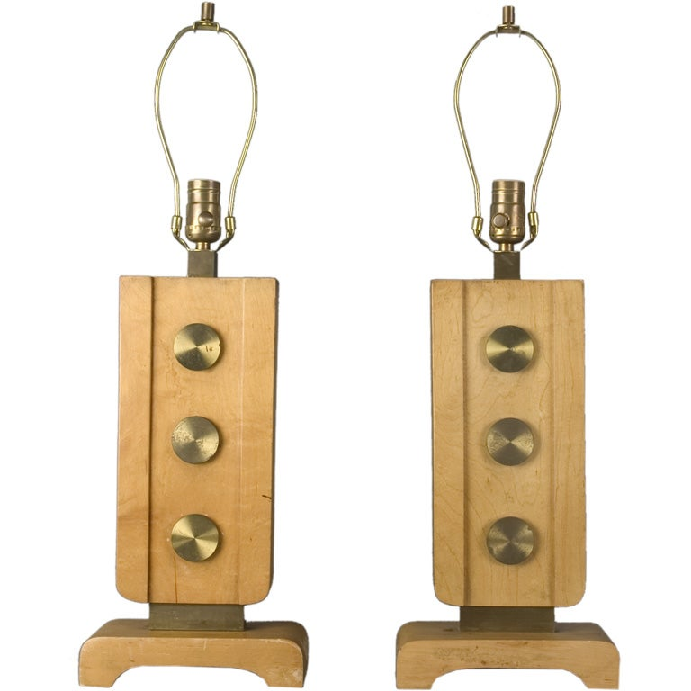 A pair of brass and blond wood table lamps