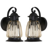 A pair of lobed glass exterior wall lanterns