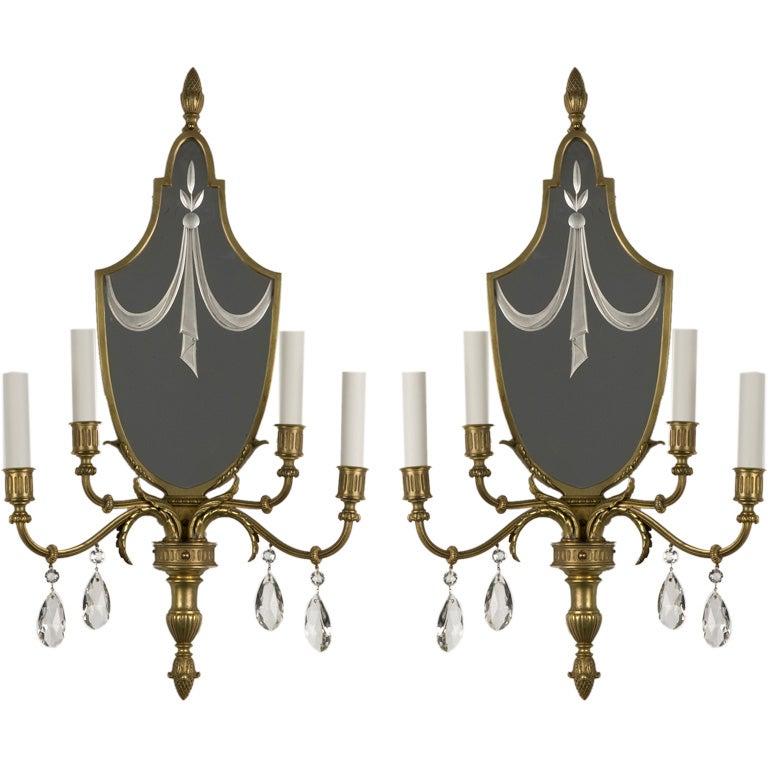 A pair of antique mirrorback four-arm sconces