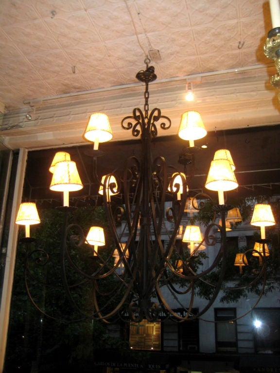 Pair of Large Italian Wrought Iron Chandeliers In Excellent Condition For Sale In New York, NY