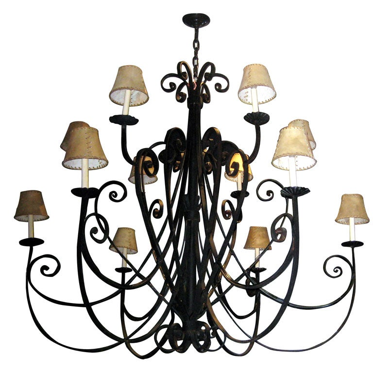 Pair of large, Italian wrought iron chandeliers with scrolling arms and with 3 levels of lights. Total of 18 lights each.   Measurements Height: 64