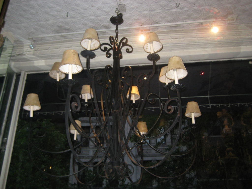 Mid-20th Century Pair of Large Italian Wrought Iron Chandeliers For Sale
