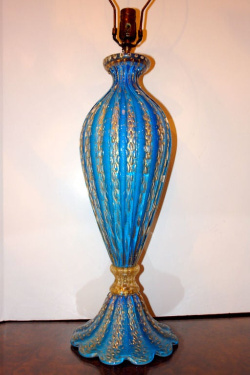 A circa 1940s single hand blown blue Venetian glass table lamp with gold details.  Measurements: Height of body 23