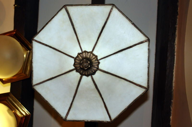 Set of 10 circa 1930's English neoclassic-style leaded glass light fixtures. Sold individually.  Measurements: Height: 19
