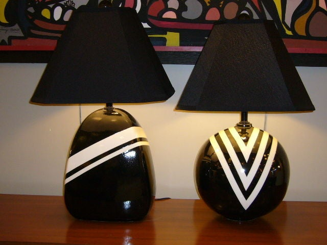 SOLD APRIL 2010 We call them the Duke & Duchess!  Striking Black & White pop art geometrics highlight this pair of en suite lamps.  Bold stylised chevron graphics in a porcelain like mirror glaze.  Fun complimenting shapes.    Matching black ball