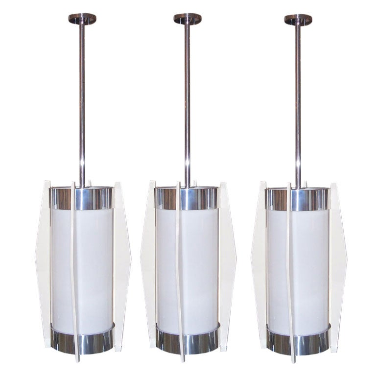 a set of three deco oversized industrial hanging lights at
