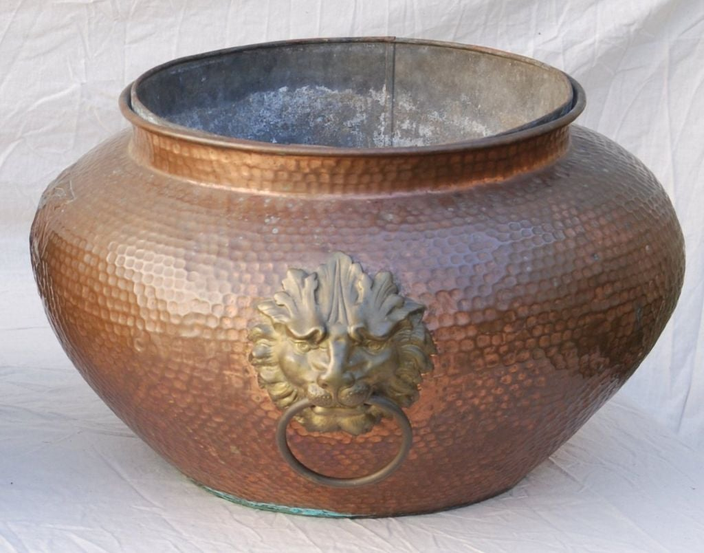 An Unusual Pair Of Large Regency Hand Hammered Copper