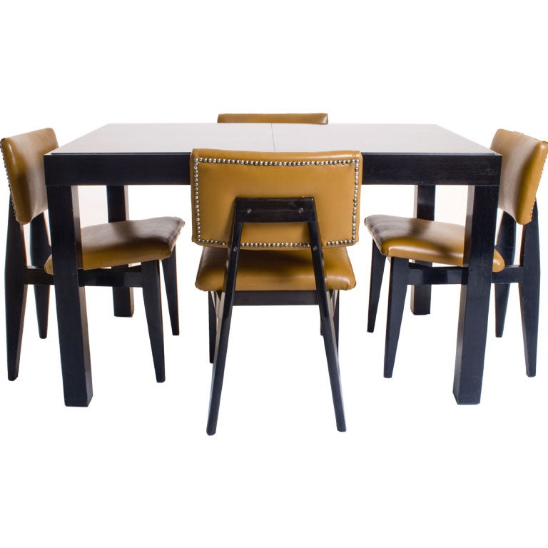 george nelson expandable dining table and four chairs at