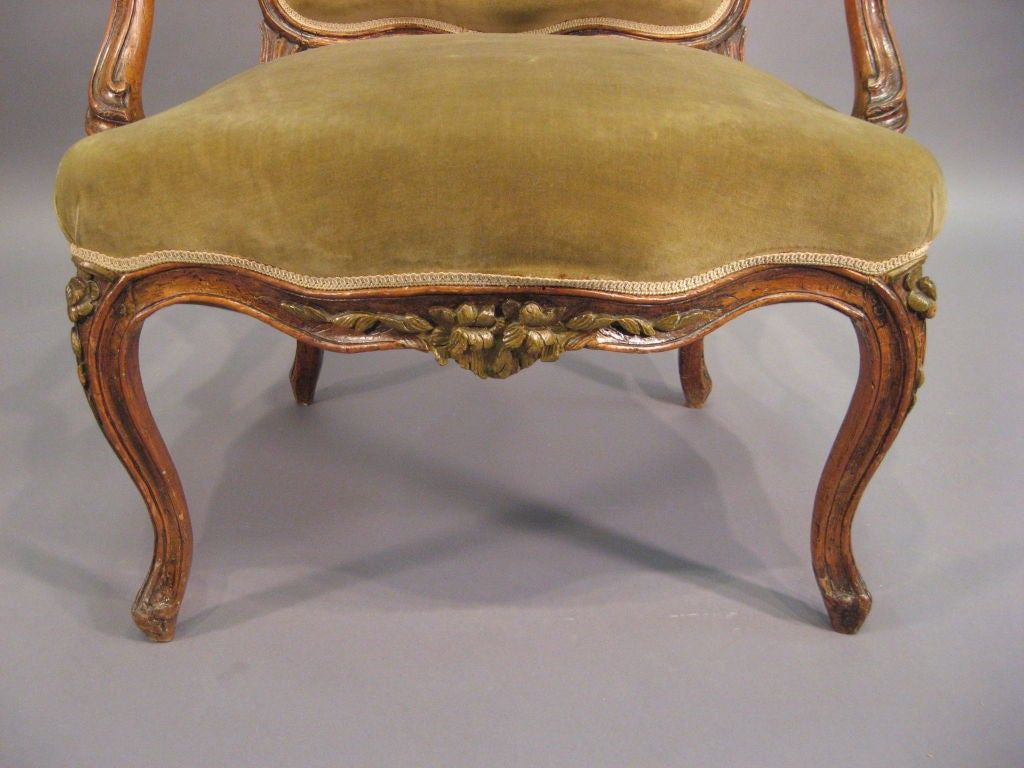 Carved Louis XV Fauteuil in Walnut with Painted Accents, France c. 1760 For Sale