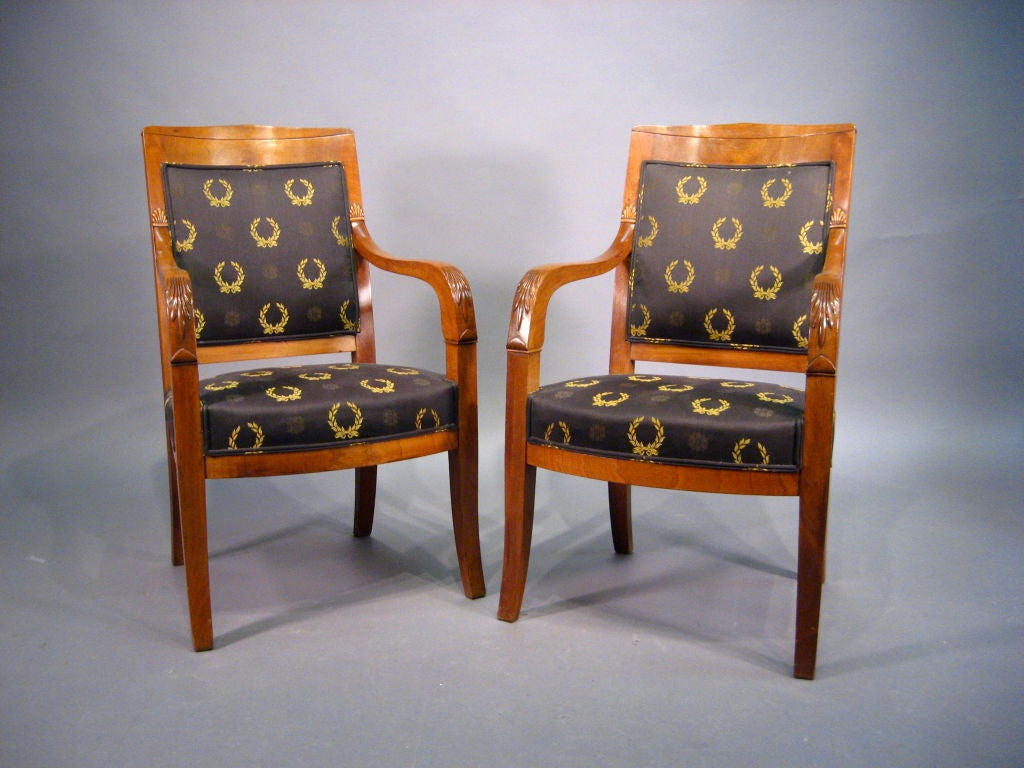 A refined pair of Empire design Fauteuils, each constructed in richly-figured mahogany. The pair French in origin, and dating from the fourth quarter of the 1800s.