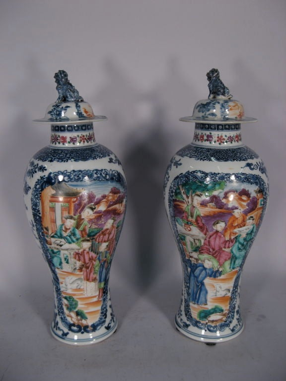 A fine pair of Chinese Export porcelain vases and covers. Dating from the third quarter of the 1700s, and originating in the Jingdezhen region of China, near the important China Trade port of Canton. 