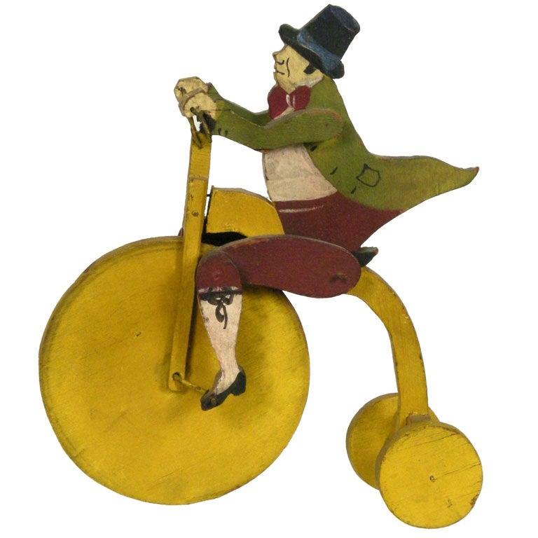 WHIMSICAL GENTLEMAN ON BICYCLE TOY