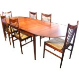 Large Rosewood Dining table and 6 chairs by Arne Vodder