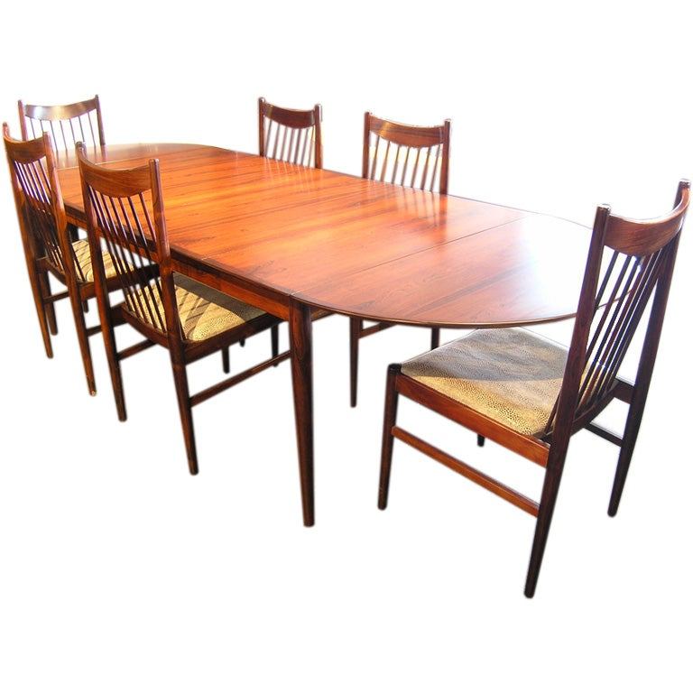 large rosewood dining table and 6 chairs by arne vodder at