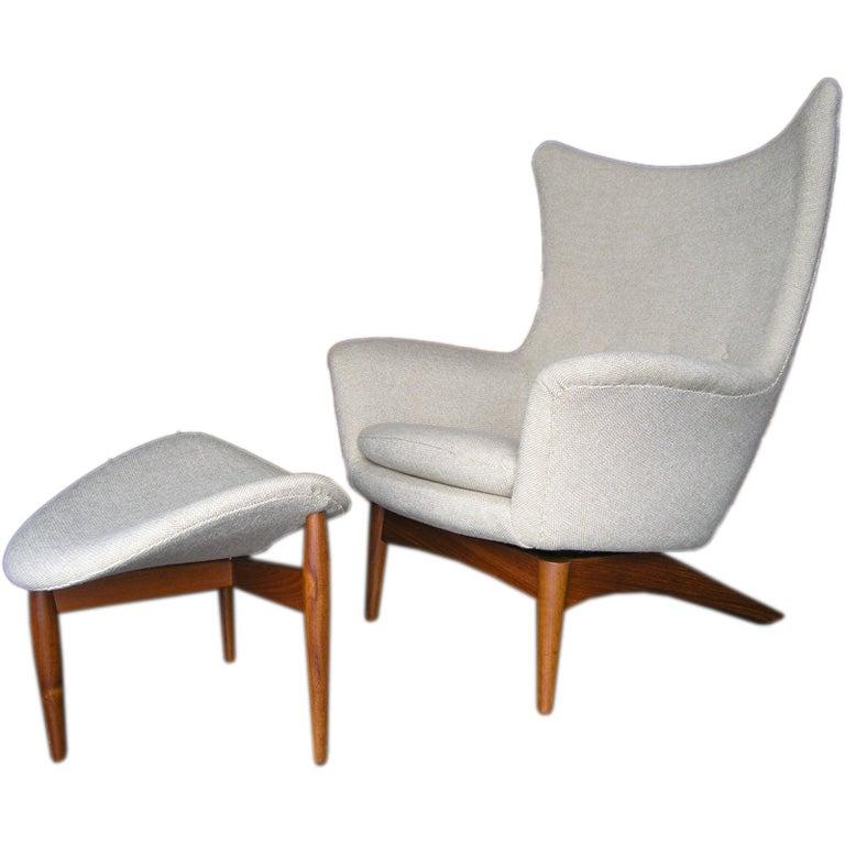 adjustable armchair with 3 legged ottoman by illum