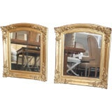 Pair of arched top gilt mirrors