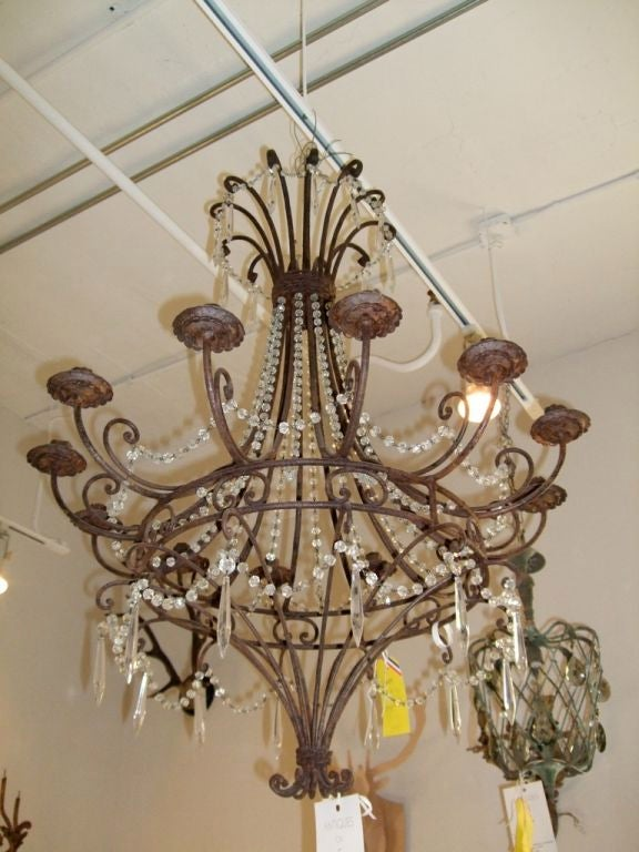 Pair of vintage wrought iron and crystal beaded chandeliers. Oxidized patina on ironwork, not electrified.