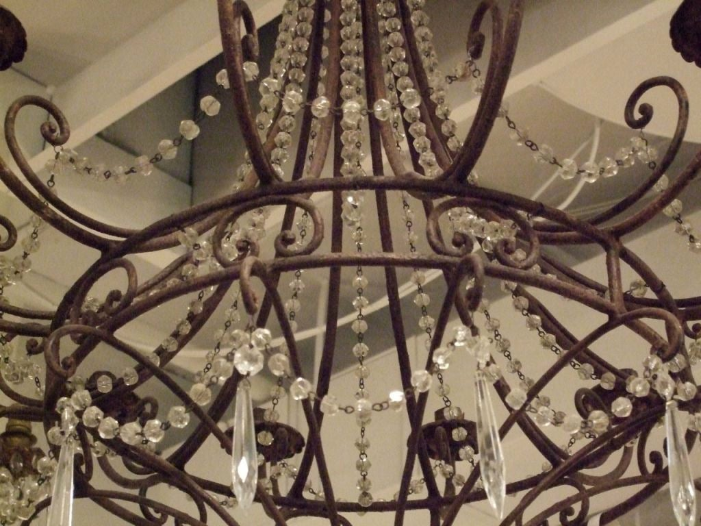 20th Century Pair of Vintage Iron and Crystal Chandeliers For Sale