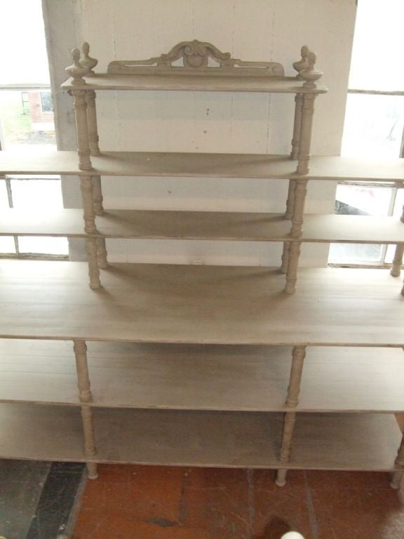 Large-scale antiqued grey painted shelving unit. Pair available.
