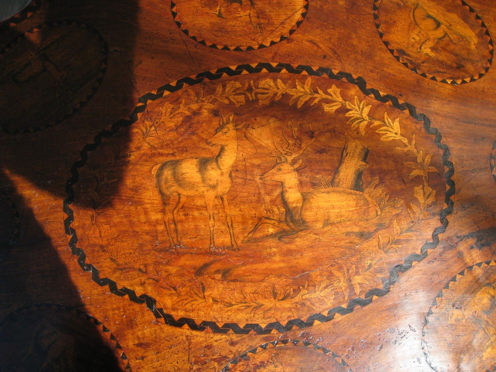 Carved Black Forest Walnut and Marquetry Tilt-Top Table For Sale