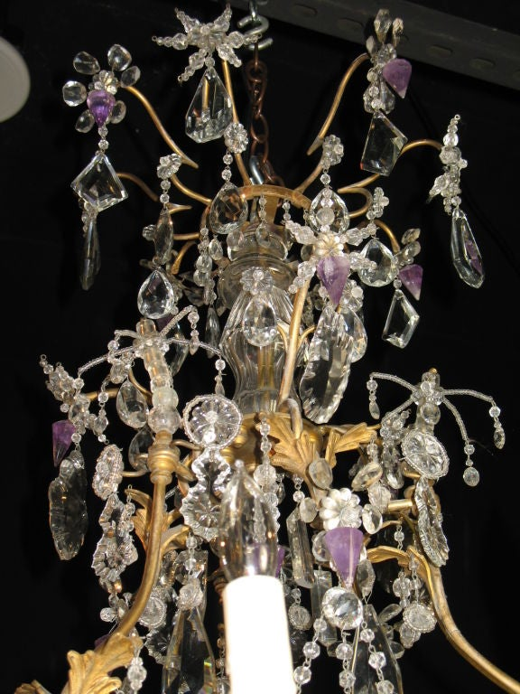 French crystal chandelier with delicate bronze frame with leaves, an array of crystal beads, cut-crystals and amethyst rock crystal drops, a lovely central beaded spray with large crystal spear, and a cut-crystal ball. Electrified with six lights.