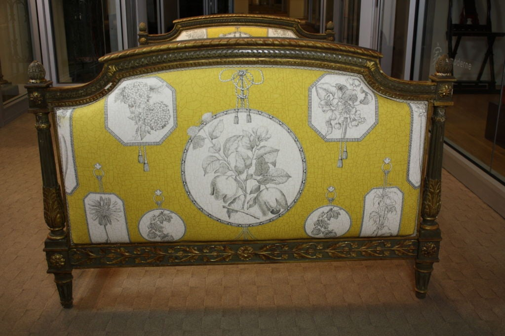French painted daybed, nicely carved, in the neoclassical style (Louis XVI period) with some traces of gilding.  Side rails are beautifully carved. Newly-upholstered in Pierre-Frey fabric, and includes three cushions and custom coverlet sized for a