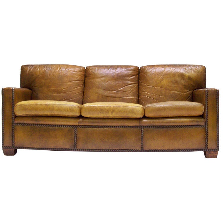 large leather sofa with nailhead trim