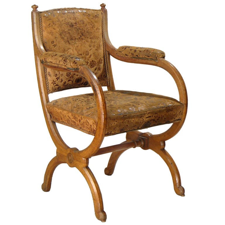 An Oak Library Chair With Stamped Leather Upholstery At