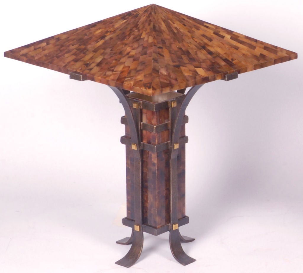 Constructed of tesselated horn over translucent reinforced resin, cradled in hand wrought iron bases,ornamented with square brass studs.  The form, reminiscent of Frank Lloyd Wright's designs, would work particularly well with arts and crafts,