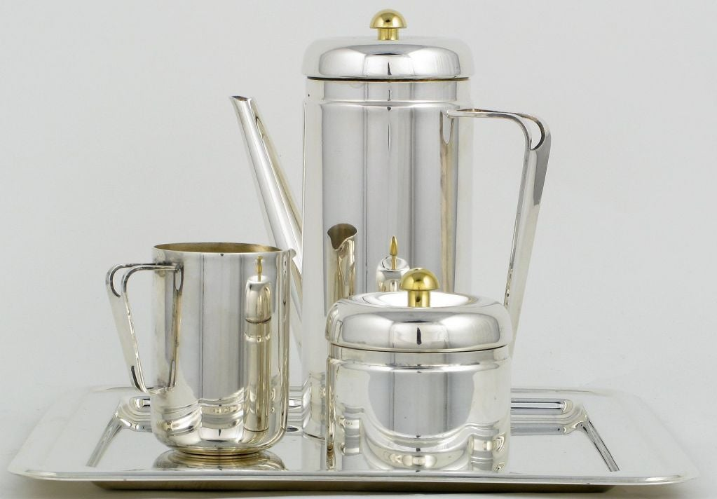 A very fine silver plated and brass coffee service signed PM Italy. The set includes the coffee pot , cream server, sugar bowl and serving tray.