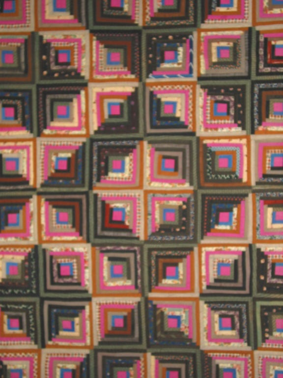 Mennonite quilters in Pennsylvania freely used prints and bright colors to make exceptional geometric designs. Wool challis in many prints and solids are arranged to form a striking graphic example. Rich magenta details provide a surprisingly bold