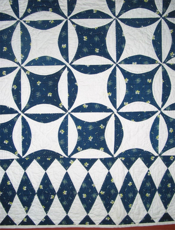 Skilfully pieced and elaborately quilted, a superb example of a very difficult design to execute. A less ambitious quilter might have been content to create all of those perfect, never-ending circles in the main body of the quilt. However, an