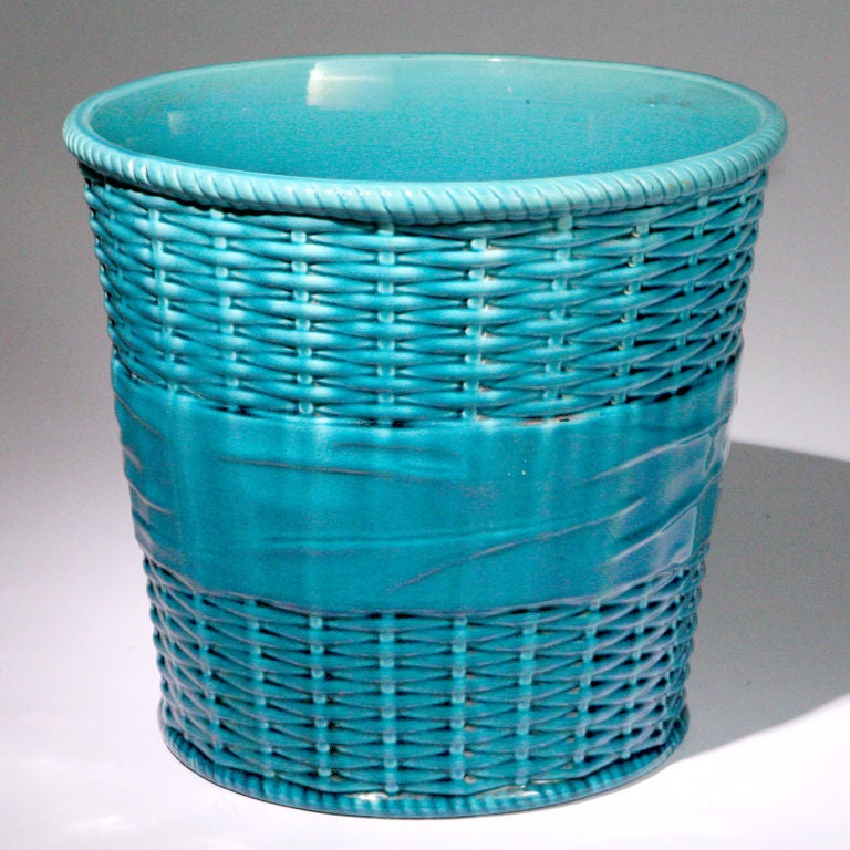 Large Minton Majolica planter in turquoise designed in a basketweave pattern with a large tied bow arround the middle. Impressed: Mintons Pattern #2721 Date Code: 1911.