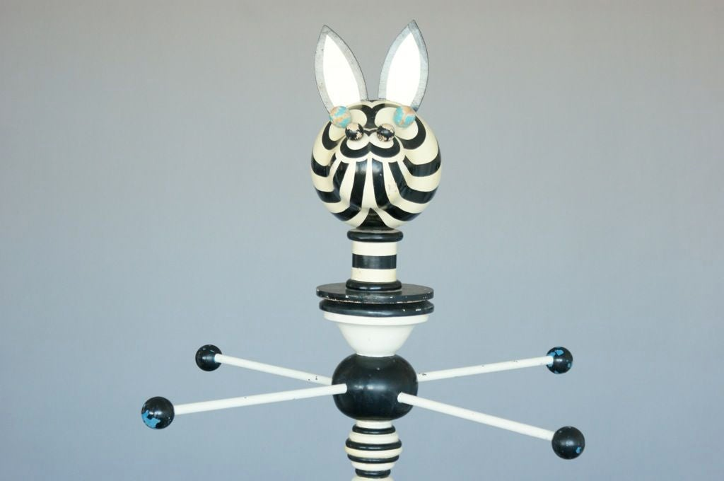 Totemic coat stand, striped Giraffe like figure, with double hanging levels. Once used in Neiman Marcus for store displays which some were styled by Alessandro.