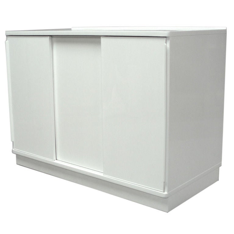 Amazing A White Lacquered Sliding Door Cabinet By Edward Wormley For Sale