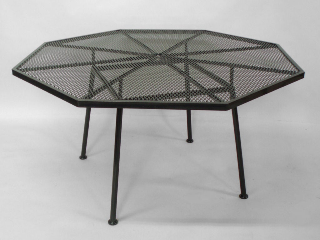 Wrought iron and mesh table with chairs by russell woodard for Iron furniture