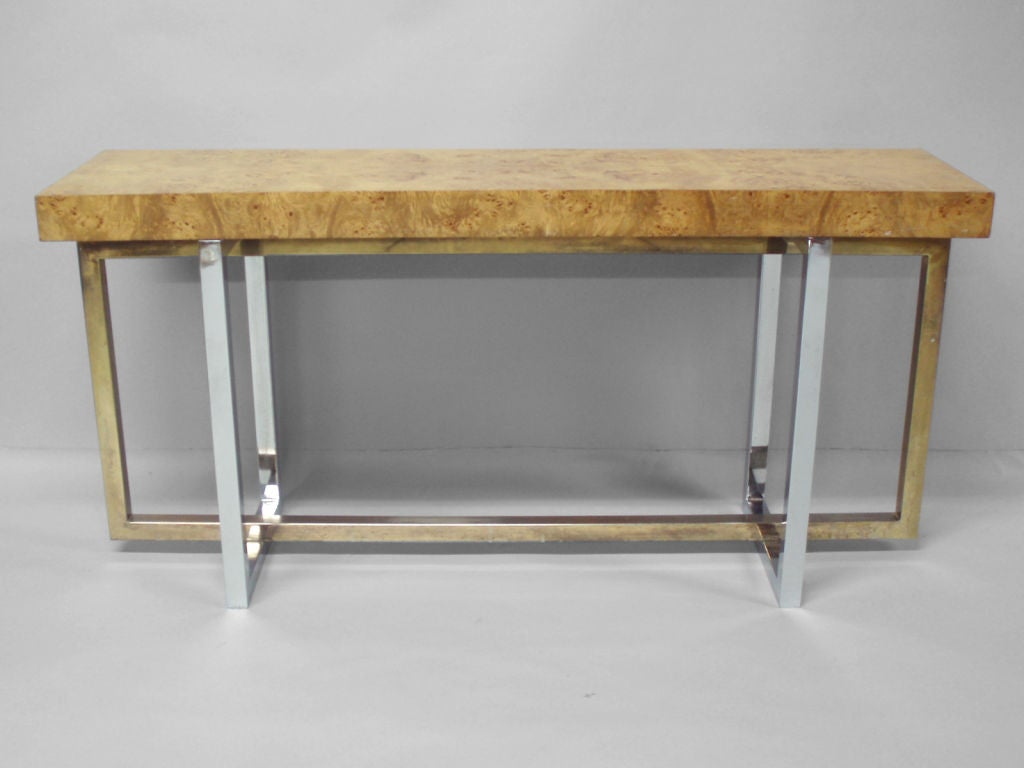A Blonde Burled Wood Console Table With A Chrome Base At