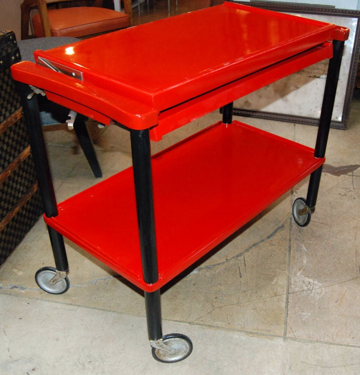 1930s German Bauhaus era black and red lacquer finis tea trolley with top adjustable.Depth when top open 30