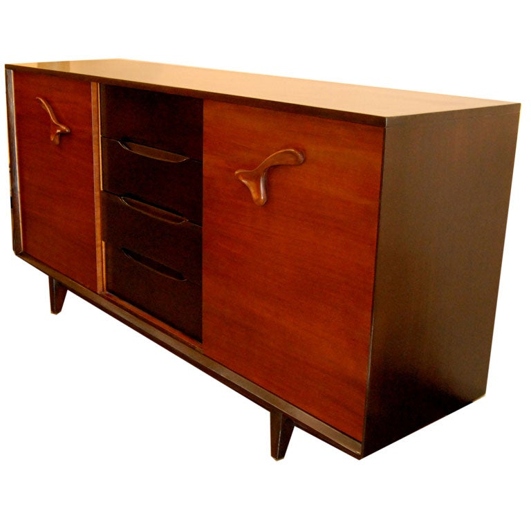 1950s sideboard with two sliding doors and three front drawers designed by Paul Laszlo for Brown Saltman.