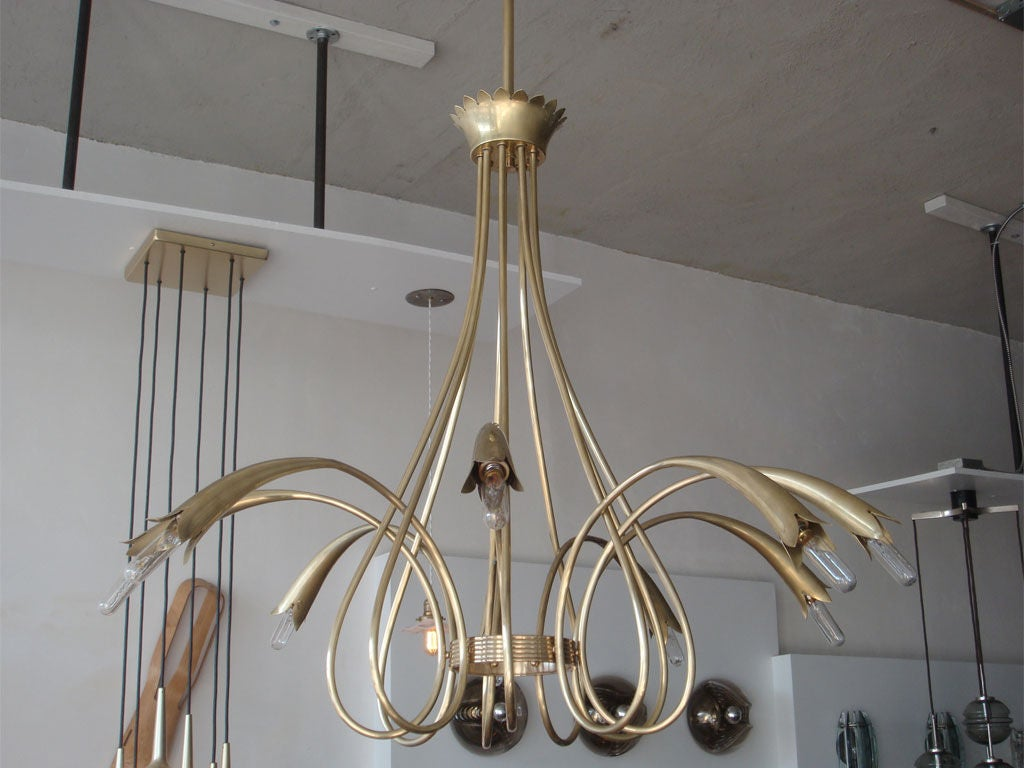 nine arm brass chandelier<br /> current drop [with original canopy and rod] brings total drop to 46.5