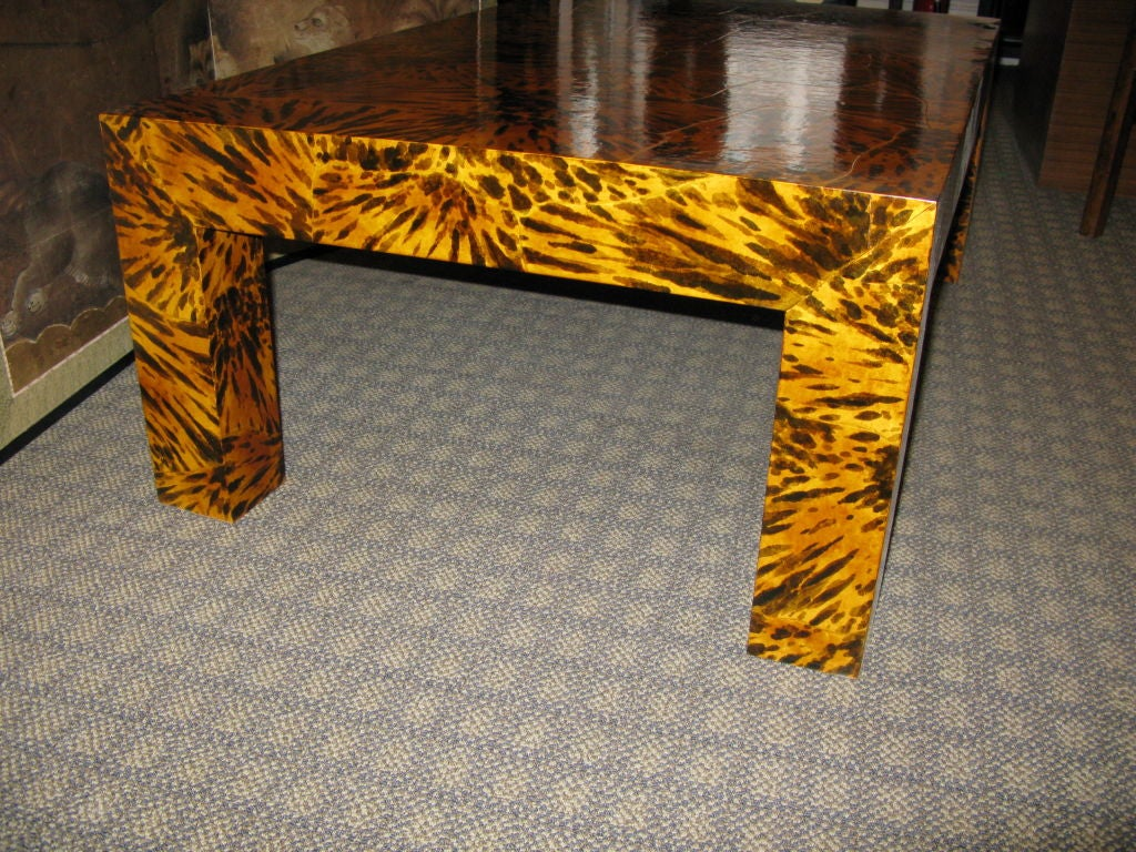 A wonderful large Parsons style coffee table with handpainted faux tortoise shell design, finished in cashew lacquer.  The cashew lacquer finish makes this table quite durable, since it is naturally water proof, and burn resitant.<br /> <br /> May