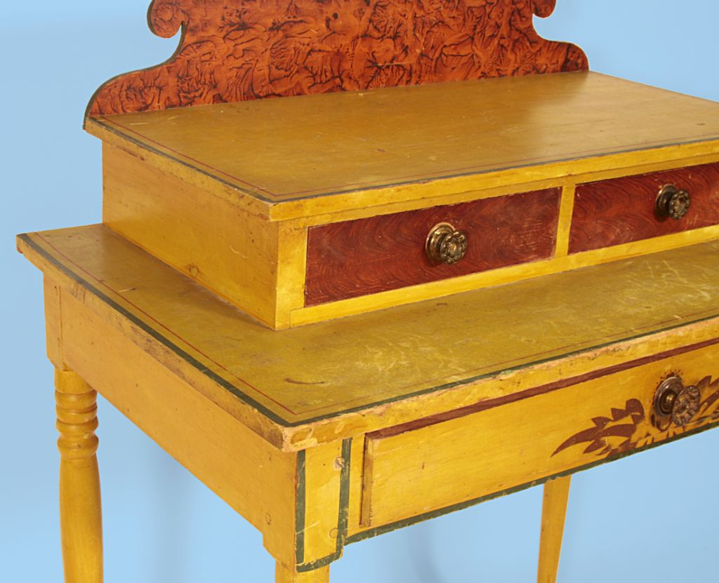 NEW ENGLAND DRESSING TABLE IN ORIGINAL PAINT WITH A CHROME YELLOW GROUND & VINEGAR DECORATION:  This beautiful, Northern New England, paint-decorated dressing table has a chrome yellow background and a beautifully scrolled backsplash with