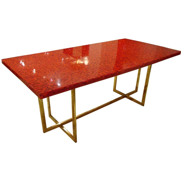 A dining table with a red resin and stone top by jean for Best dining table brands