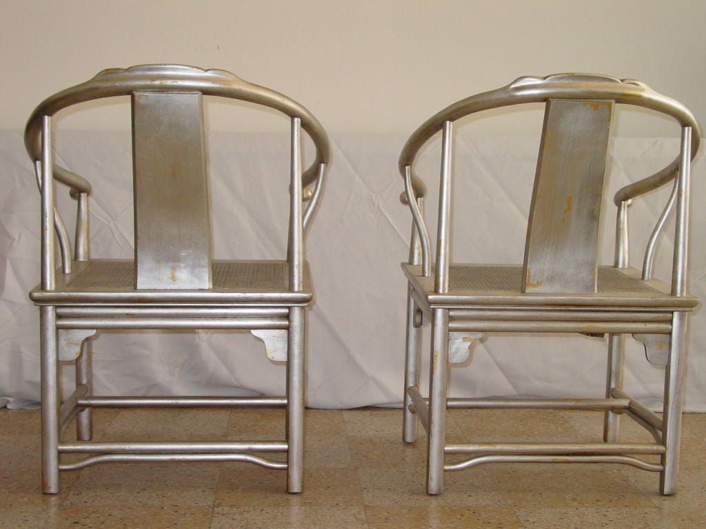 Late 20th Century Pair of Silver Leaf Asian Chairs