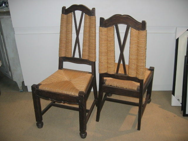 Pair of lightly cerused oak chairs with original rush seats.
