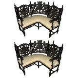 Pair of 19th c. Carved Corner Benches with Heraldic Carving