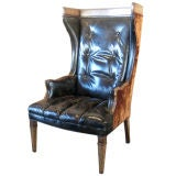 Leather and velvet wing back armchair.