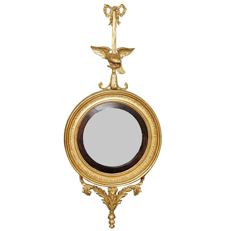 A Large Convex Giltwood Mirror With Eagle And Bowknot