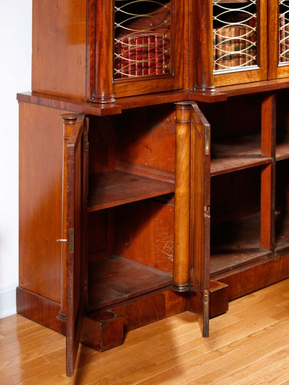 English Regency mahogany breakfront bookcase with an arched top