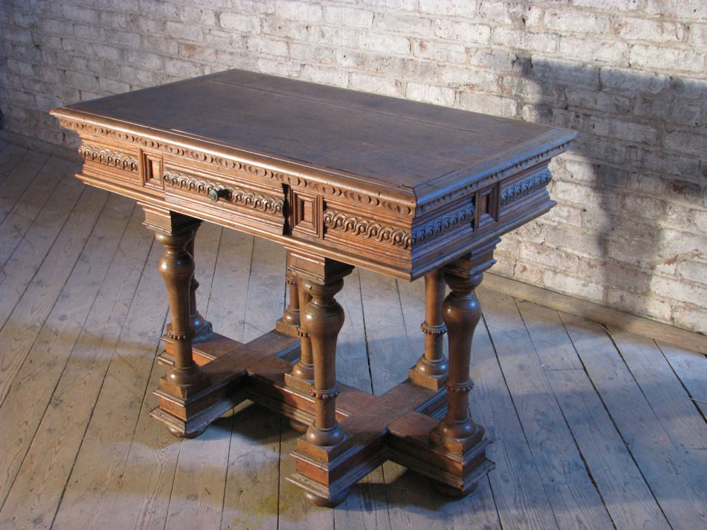 Small size cross Lorraine table with a strong sculptural presence, the carved frieze containing one-drawer, the seven turned legs connected by a Cross-Lorraine shaped base, beautiful light color.